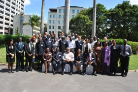 Commonwealth meeting in  Dar es Salaam,Tanzania, May 2012,seated in the middle are:Ghana's Ex-President Jerry Rawlings,Commonwealth's Deputy Secretary General,Ms.Masire Mwamba,Uganda's Minister of Information,Hon.Ruhakana Rugunda and other dignitaries from Uganda,Tanzania,Kenya,Rwanda, Zambia,Sychelles,Ghana,Kenya,Nigeria and UK
