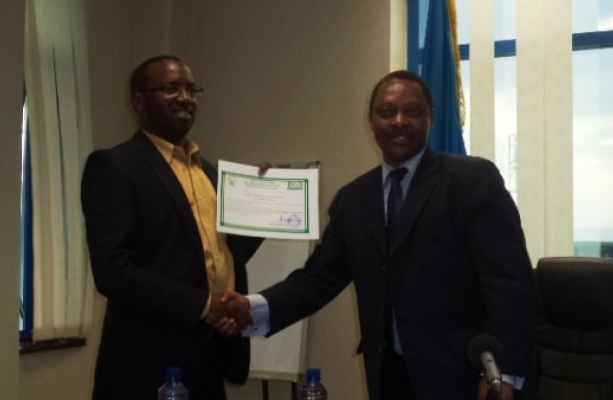 Recieving the certificate from Prof.Shyaka